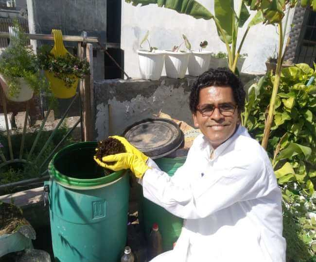 Praveen Mishra is doing gardening at terrace through making compost from kitchen wastes